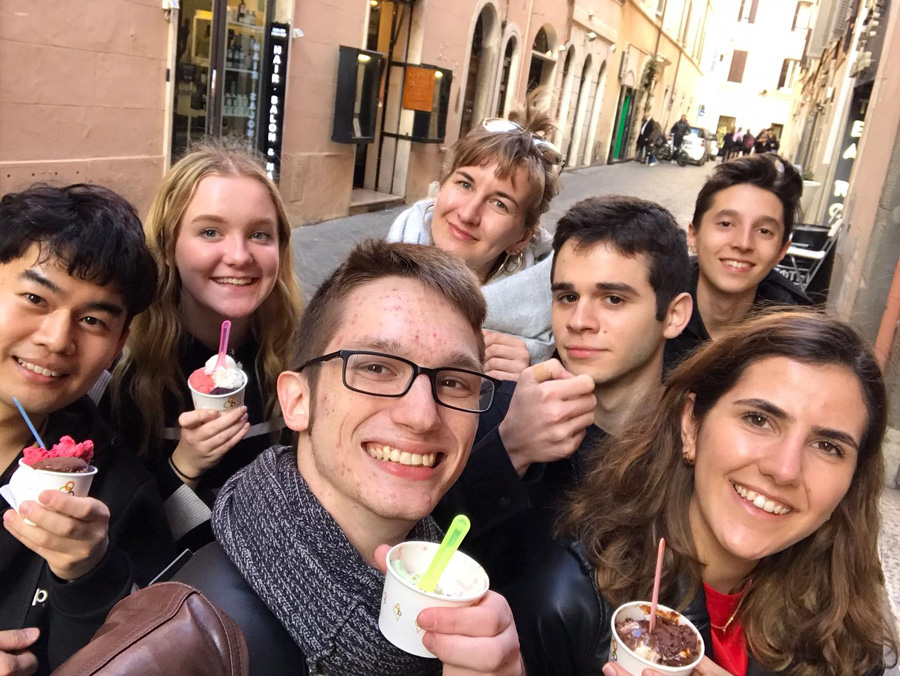 Ice cream and friends on a street in Rome