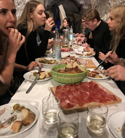 Eating with friends in a grotto in Rome