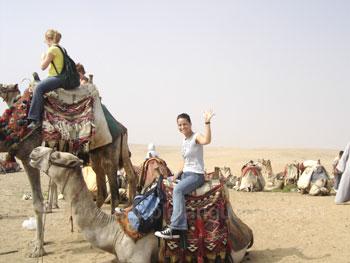 Student riding a camel