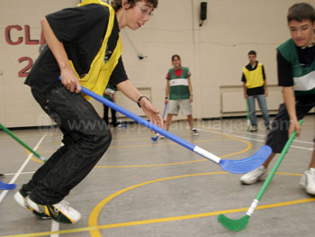 Playing indoor hockey
