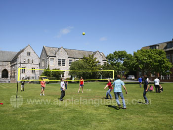 Playing volleyball on the school grounds