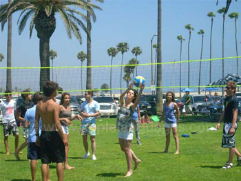 Playing volleyball with classmates