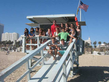 Students on iconic Lifeguard Tower
