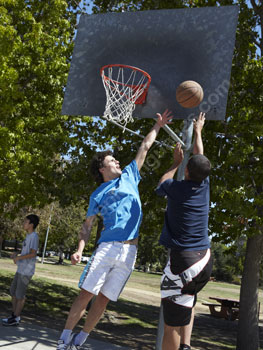 Playing basketball in the park