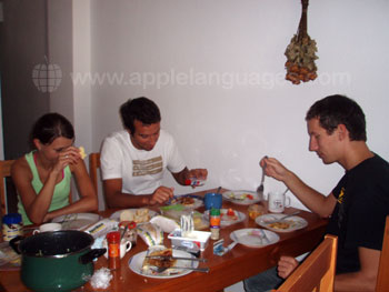 Students having dinner in shared apartment