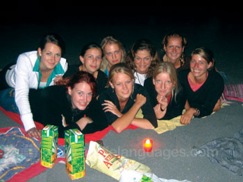 Students on the beach at night