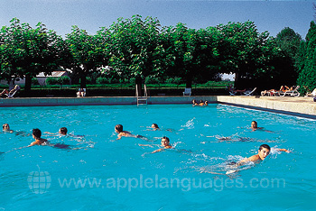Students enjoying open air pool