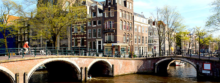 Amsterdam canal with cyclist