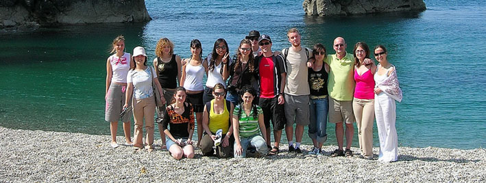 Students on a beach near Bournemouth