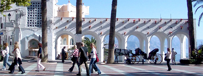 Nerja promenade with horse drawn carriage