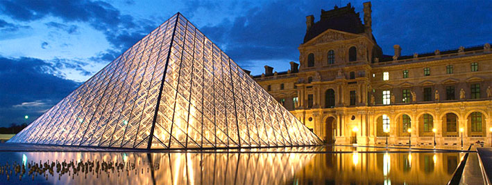 The Louvre in Paris at dusk