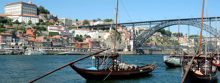 Eifel bridge and rabelo boats in Porto