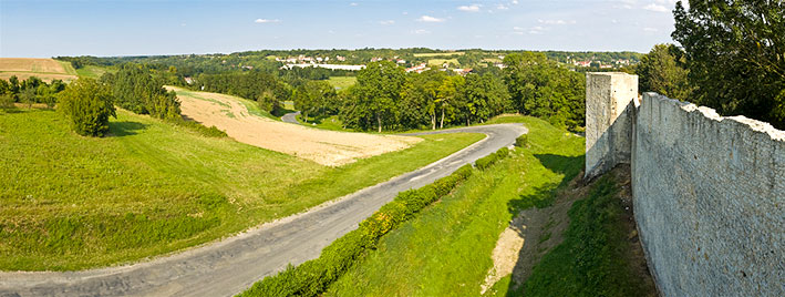 Rouen countryside road with white wall