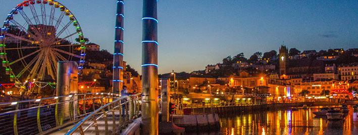 Torquay harbour with Ferris wheel at night