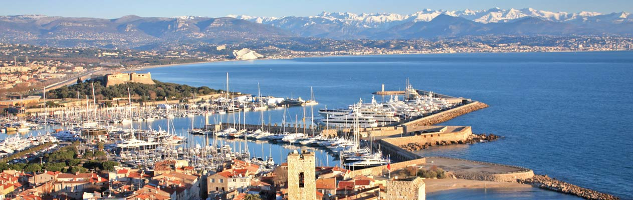 View over Antibes Marina with the Alps
