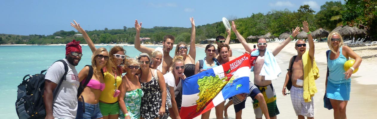 Happy Spanish students on a beach in Sosua
